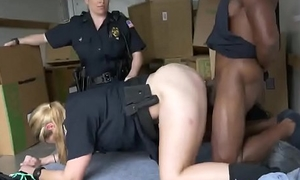 Sexy cops dupe black chap into threesome and he dominates their slimy pussies