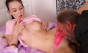 Katia is eaten out and her pussy made wetter by her defy and plays with her breasts as she is aroused and turned on by her man.